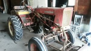 Front blade for a farmall.