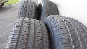 Set of four P265/70R18 Continental Contitrac all season tires.