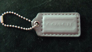 Medium gray leather Coach hang tag for a purse or keys