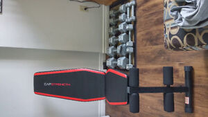 Weight bench and dumbbell set.