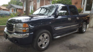 Gmc sierra low kms and loaded with sunroof and rear dvd.
