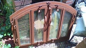 LARGE ANTIQUE FIREPLACE INSERT WITH SCREEN AND BIFOLD GLASS DOOR