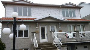 bright spacious 7 1/2 with backyard in brossard