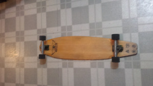 Longboard hand engraved with magnifying glass