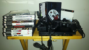 PlayStation 2 with 10 games memory card and two joysticks