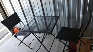 glass patio table and 2 chairs free delivery