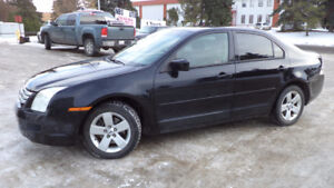 06 Fusion - 4dr - 5spd manual - LOADED - MAGS - A/C -ONLY 110KMS