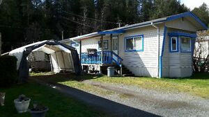 MOBILE HOME IN CULTUS LAKE VILLAGE WITH YEAR ROUND LIVING