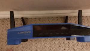 Wireless routers for sale (Linksys WRT and Amped Wireless)
