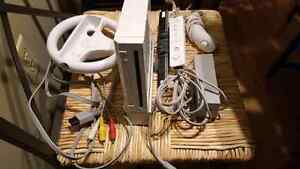 Wii console with one remote and wheel. 100 obo