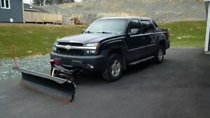 2003 Chevrolet Avalanche with snowbear plow