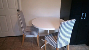 small kitchen table and two chairs
