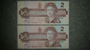 2 1986 2$ bills mint uncirculated and in sequence only 10$...... London Ontario image 1