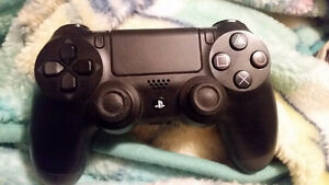 PS4 remote for sale.