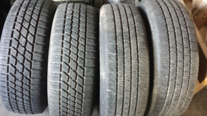 4 small car tires on rims P195/70R14
