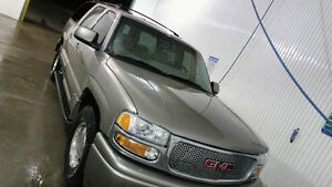 2000 YUKON XL with Denali front clip and bumpers.
