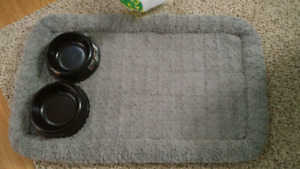 Dog dishes and big dog bed