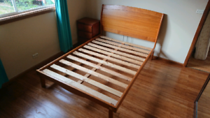 solid wood queen bed and bedside table