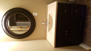 Modern dark brown vanity with faucet and mirror
