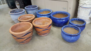 9 clay pots. various sizes per images
