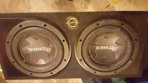 Huge speakers in sub box with deck and amp