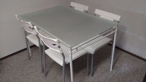 Ikea glass topped dining table and 4 chairs