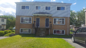 3 bedroom 2 level apartment available July 1st