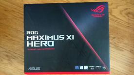 Intel Core i9 9900k CPU and Asus ROG Maximus XI Hero motherboard.
