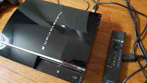 Playstation 3, chargestation, 3 controller/remote, 22 games $150