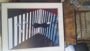 2 pictures for sale 1 is a layman newman print