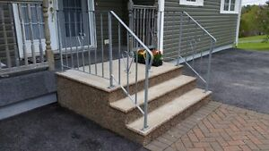 Hollow core cement front door step with stainless steel railing