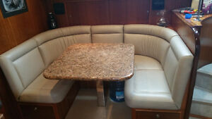 Solid granite nook table top and leather seats .