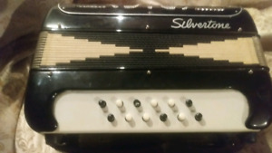 Silvertone accordian with hard case
