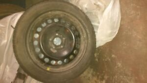 """Ford 17""""×7"""" 5×114.3 with Michelin 215 60 17 snow tires"""