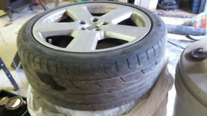 4 Slightly used Audi A4 summer tires on rims