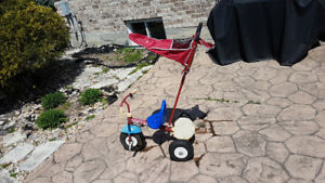 Radio flyer tricycle with Adult Steer & Stroll and sun shade