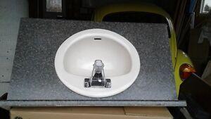 Toilet, sink and vanity top