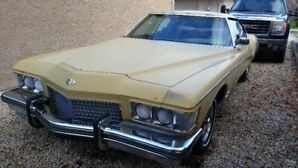 73 Riviera and 59 Olds