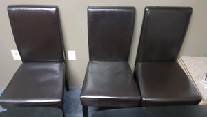 3 brown dining chairs