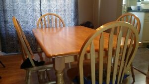 kitchen table with four matching chairs
