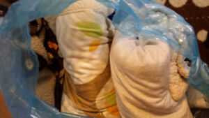 Bag of crib bedding and sheets