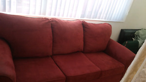 2 Beautiful sofas ..both microfibre ..1 choc 1 Red also new Beds