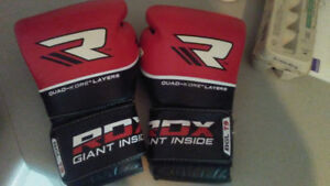 Booster mma gloves and RDX boxing gloves. 200 dollars for both.