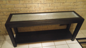 Nice black and silver glass top console table.