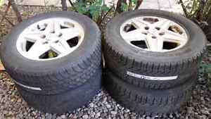 """Used winter tire with Mag 225 60 16"""""""