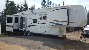 Cedar creek camper like new must go.