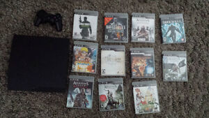 PS3 Slim bundle One controller and lots of games