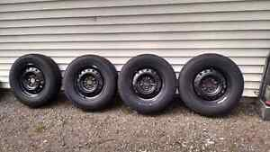 FOUR  215/70R16  TIRES AND RIMS