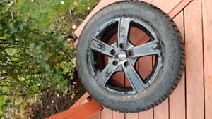 Set of 4 Winter GISLAVED NORD FROST tires on MOMO WIN PRO rims