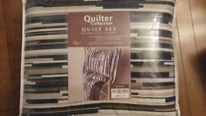 New in bag Queen size quilt set. (2 pillow shams with quilt)